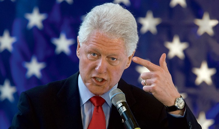 blill clinton shoots himself in the head with the finger he used to assault dozens of women
